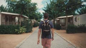 Male tourist walking between houses. stock video footage