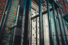 Shot from below of an iron gate in front of a door royalty free stock image