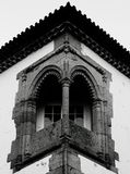 Open window on the vertex. Shot  in black and white detail on the sculpture on the facade of this historic building representing some  characters / animals / Royalty Free Stock Images