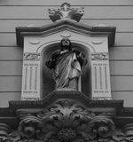 Holy man standing still. Shot and black and white, detail on the sculpture on the facade of this historic building representing some plants / flowers / animals/ Royalty Free Stock Photos