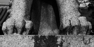 Claws of the lion. Shot in black and white, detail on the sculpture representing a lion outside the temple. Set in Kyoto, Japan, Asia Stock Image