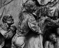Praying characters. Shot in black and white, detail on the sculpture on the square representing some characters. Set in Vitoria, Euskadi, Spain, Europe Royalty Free Stock Images