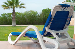 Chaise longe near apartments. Shot of blue chaise longe near apartments stock photos