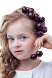 Shot of blue-eyed girl with cherries on her head Royalty Free Stock Images