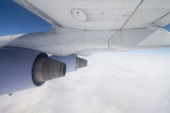 Shot of a Boeing wing at cruising. Altitude over clouds Stock Photography