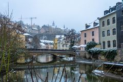 Snow covered Grund, the historic part of Luxembourg City situated on the banks of Alzette river stock photo