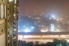 Shot of building on foggy night in Delhi Stock Photo