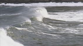 A wave building up. A shot of a building up wave on the ocean stock video footage