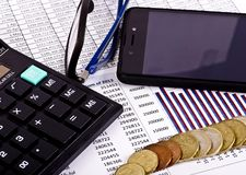 Business tools, calculator, pen and spectacles with money royalty free stock photos