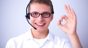 Shot of a call center operator showing ok Royalty Free Stock Photo