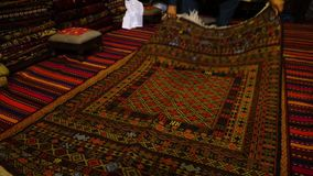 Beautifully woven carpet. A shot of a carpet made from Afghanistan being laid on the floor stock video footage