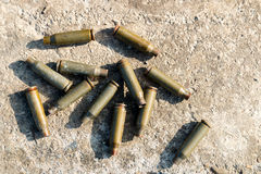 Shot cartridges from the machine gun on concrete, cartridges fro stock photography