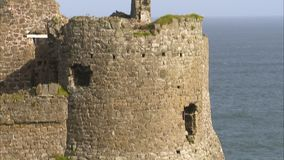 A castle on a coastline. A shot of a castle`s tower foot on a coastline stock video