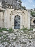 Shot of the Cava Santa main building door stock image