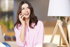 Happy female speaking on cellphone Royalty Free Stock Image