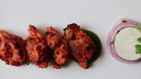 Shot of chicken tikka served in plate, Hotel Amar Villas, Agra, Uttar Pradesh, India stock footage