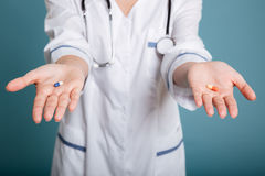 Shot of choice between two different pills stock photography