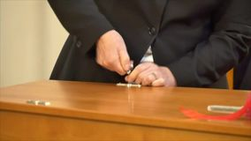 Closing the lid of a casket in a funeral service. Shot of closing the lid of a casket in a funeral servicen stock footage