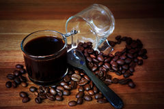 Shot of coffee and roast coffee bean on wood table stock photo