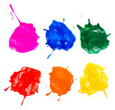 Shot of colored paints splashes blobs isolated Stock Images