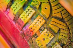 Shot of colorfully painted car tire on an old, crashed car wreck. Kids are having fun, making drawings and graffiti art, paint on wreck and tires with green royalty free stock photography
