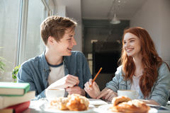 Shot of conversation of two students in cafe. Shot of conversation of two pretty young students in cafe Royalty Free Stock Images