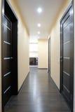 Shot of a corridor with three wooden doors Stock Images