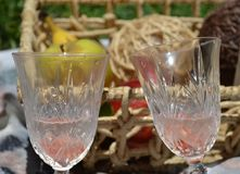 Couple of glasses ready for a romantic date outdoors stock images