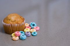 It`s a Breakfast Time Muffin and Cereal. A shot of a couple of a muffin with cereal Stock Images
