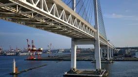 Shot of cruise passing under yokohama bridge. Wide shot of cruise passing under yokohama bridge stock video footage