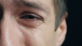 Shot of Crying man with tears in eye closeup. Crying man with tears in eye closeup stock video