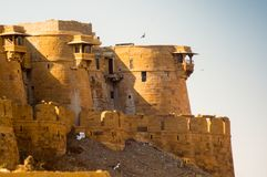 Shot of the curved sandstone walls of an indian fort. Curved sandstone walls of the famed golden fort in Jaisalmer rajasthan india. This famous tourist Royalty Free Stock Photo