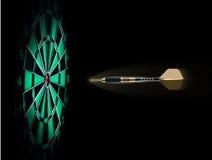 Shot of darts in bullseye on dartboard. On dark background Stock Photography