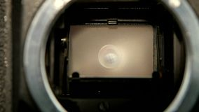 Shot of diaphragm camera shutter blade in slow motion, closeup. Shot of diaphragm camera shutter blade in slow motion, screen film frames change, background of stock footage