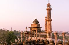 Shot of dome and spires of a mosque. Shot of the domed roof and spires or minars of Asfi mosque shot from the famous rooftop of bara imambara in Lucknow uttar Stock Photos