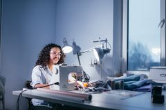 Shot of dressmaker sewing patten in stitching machine Royalty Free Stock Images