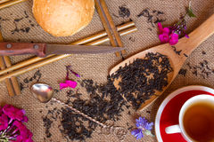 Shot from the dry black tea with flowers Stock Photography