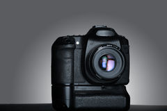 Shot of dslr camera in gray background Royalty Free Stock Image
