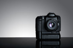 Shot of dslr camera in gray background Royalty Free Stock Photography
