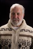 Shot of an elderly man. Shot of a bearded older man in a sweater with that Hemingway look stock photo
