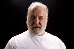 Shot of an elderly man. Shot of a bearded older man in a T-Shirt with that Hemingway look royalty free stock photography