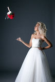 Shot of elegant bride throws her bouquet Royalty Free Stock Photo