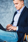 Shot of elegant businessman with intent look working on laptop. Stock Photography