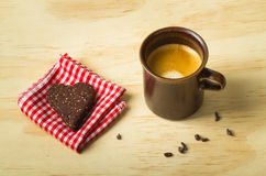 Shot of espresso with healthy paleo heart chia seed cookie. Shot of espresso with healthy paleo chia seed heart cookie retro style royalty free stock image