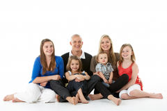 Shot Of Family Group Sitting In Studio. On White Background stock photography