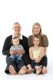 Shot Of Family Group Sitting In Studio. On White Background royalty free stock photo
