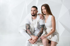 Shot of a fashionable couple posing at studio. Stock Photo