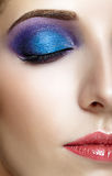 Shot of female half face with closed eye and violet -  blue make Stock Images