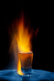 Shot on fire. Shot glass on fire against black background Royalty Free Stock Images