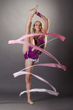 Shot of flexible young gymnast dancing with ribbon Royalty Free Stock Images